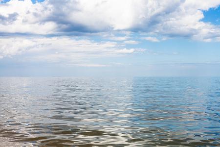 gray and white clouds over calm water of Azov Sea, Temryuk bay, Golubitskaya resort, Taman peninsula, Kuban, Russia