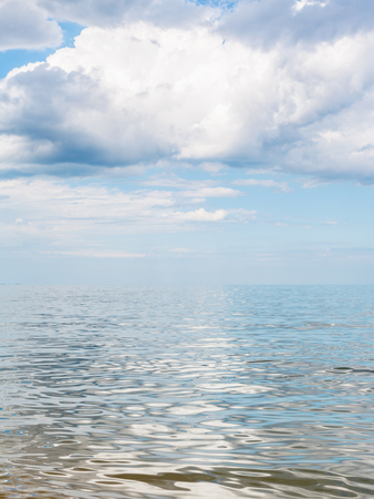kuban: big white cloud over calm water of Azov Sea, Temryuk bay, Golubitskaya resort, Taman peninsula, Kuban, Russia