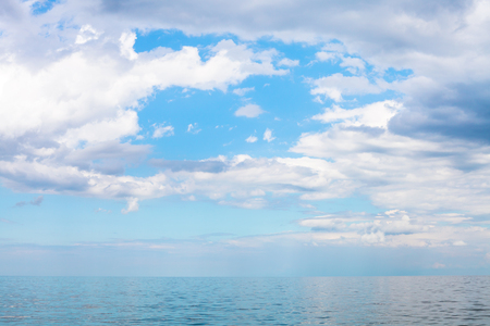 krasnodar region: scenery of blue sky with white clouds over calm Sea of Azov, Temryuk bay, Golubitskaya resort, Taman peninsula, Kuban, Russia