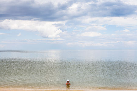 taman: girl in water of Sea of Azov, Temryuk bay, Golubitskaya resort, Taman peninsula, Kuban, Russia