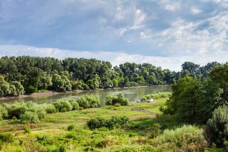 kuban: green meadow along Kuban river in summer day before rain near Slavyansk-na-Kubani town, Caucasus, Russia Stock Photo