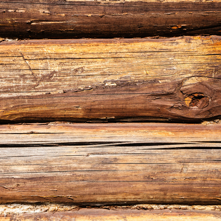 fireproof: wood texture - old oak beams of country house wall impregnated by fireproofing