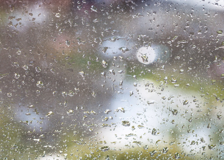 windowpane: rain drops on windowpane and blurred urban background Stock Photo