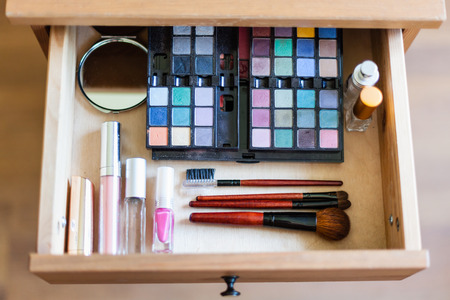 nightstand: above view of cosmetic set in open drawer of nightstand Stock Photo