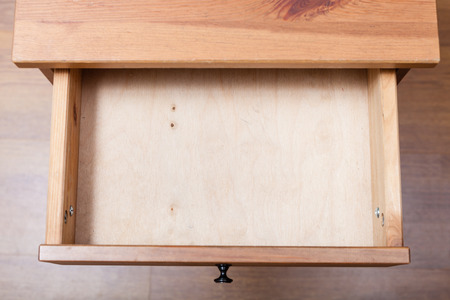 top view of empty open drawer of nightstand