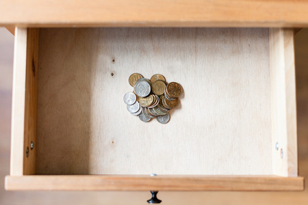 living things: above view of pile of russian coins in open drawer of nightstand