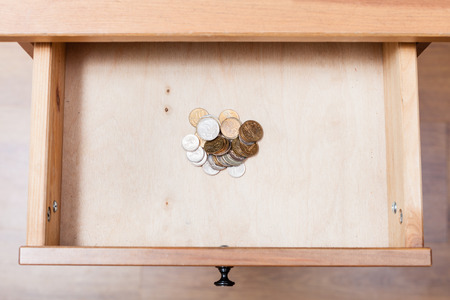 bedtable: top view of russian coins in open drawer of nightstand