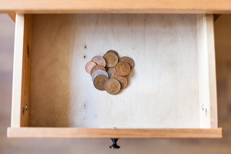 bedtable: top view of pile of british coins in open drawer of nightstand Stock Photo