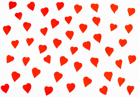 many red hearts cut out from paper on white background Stock Photo