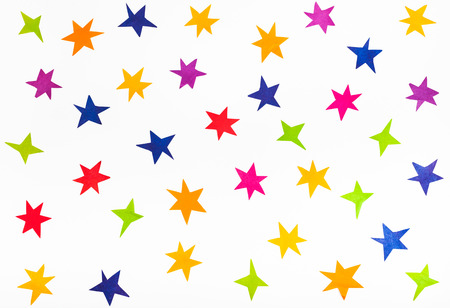 ut: top view of various stars cut out from colored paper on white background