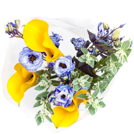 top view of bouquet from fresh yellow Calla lily, blue Lisianthus flowers and green spurge leaves isolated on white background