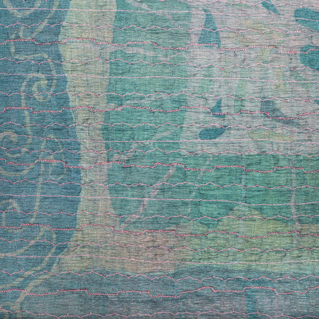 sewn up: textile square background - transparent stitched clenched green silk fabric and painted batik on background