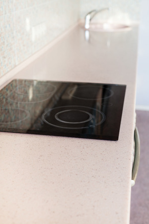 stone worktop: installing new tabletop on kitchen - new worktop from artificial stone with built-in cooking stove and sink