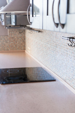 stone worktop: new kitchen worktop from artificial stone with built-in cooking stove Stock Photo