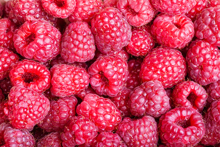 close up food: food background - many berries of fresh raspberry close up Stock Photo