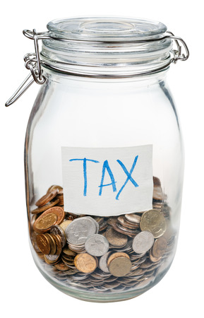 pay raise: saved coins for taxes in closed glass jar isolated on white background