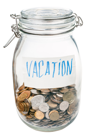 saved: saved coins for vacation in closed glass jar isolated on white background