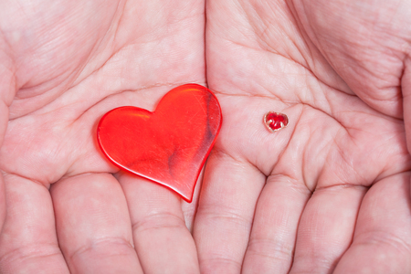 handbreadth: two red hearts in male handful close up