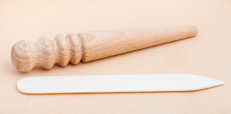 Leather crafting tool - flat and round Edge Slickers and Burnishers on natural leather
