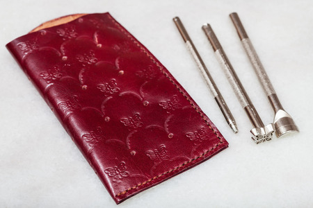 Leathercraft - new handmade leather pouch for spectacle and embossing tools on marble plate