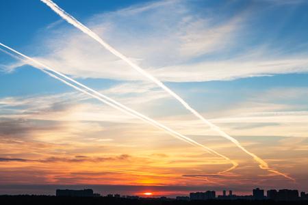 city of sunrise: early sunrise over city in summer morning Stock Photo