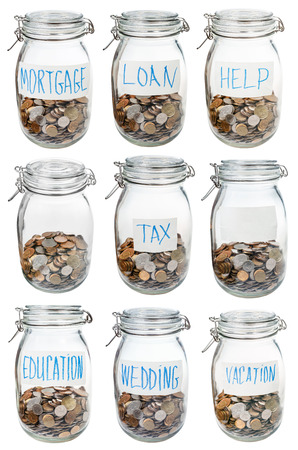 occasions: closed glass jars with saved money for different occasions isolated on white background Stock Photo
