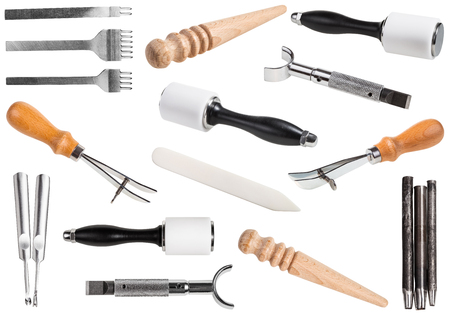 set of leathercraft tools - Slickers, Nylon hammers, Edge Creaser, Burnishers, Swivel knifes, Edge Beveler Skiving, Hole Punches, Prongs Lacing Stitching Chisels isolated on white background Stock Photo