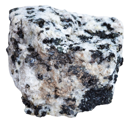 felsic: macro shooting of Igneous rock specimens - white and black granite mineral isolated on white background