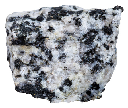 felsic: macro shooting of Igneous rock specimens - natural white and black granite mineral isolated on white background