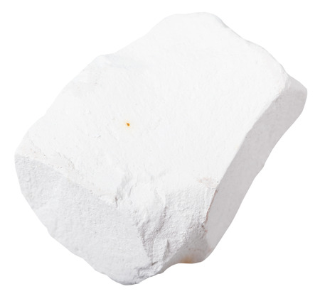quicklime: macro shooting of mineral resources - piece of Chalk rock isolated on white background