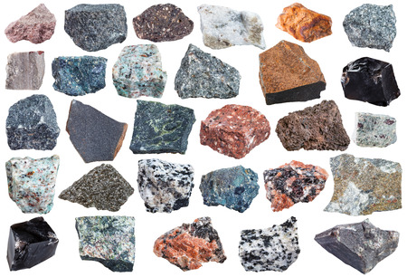 set of Igneous rock specimens - pegmatite, basalt, trachyte, orthoclase, rhyolite, andesite, dacite, granite, carbonatite, diorite, glassbasalt, dunite, gabbro, kimberlite, obsidian, etc isolated Stock Photo