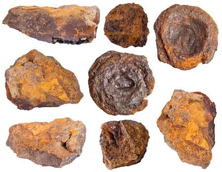ore: collection from specimens of limonite ore (iron ore, bog iron ore, brown hematite, brown iron ore, lemon rock, yellow iron ore) isolated on white background Stock Photo