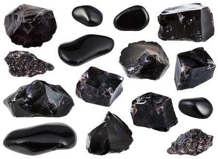 specimens: collection from specimens of black obsidian (natural volcanic glass) stone isolated on white background