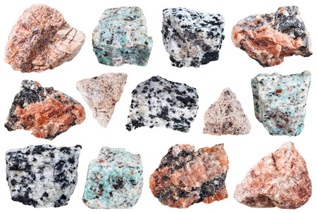 intrusive: collection from specimens of granite rock isolated on white background Stock Photo