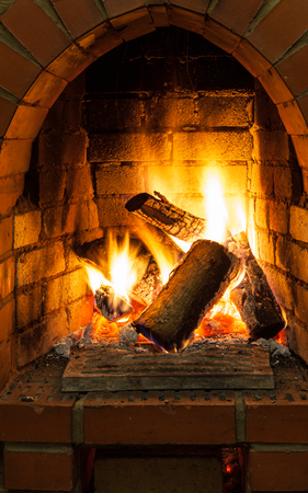 firebox: fire in fire-box of fireplace in country cottage