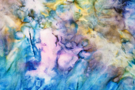nodular: textile background - abstract colored silk knotted batik