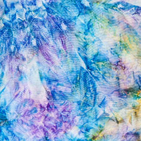nodular: textile background - abstract blue and yellow colored stitched silk batik