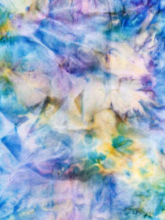 hued: textile background - abstract blue and yellow ornament on painted silk batik