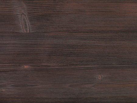 hued: textured background - wooden surface of dark brown color close up