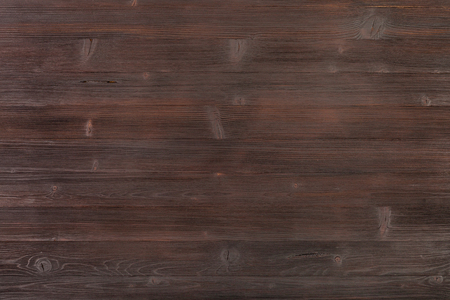 hued: textured background - wooden surface of dark brown color