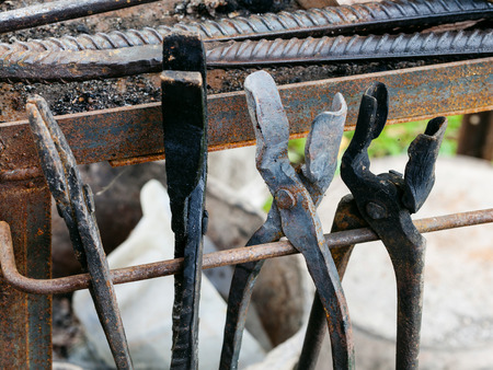 Backyard Forge forge tongs in country outdoor blacksmith on backyard stock photo