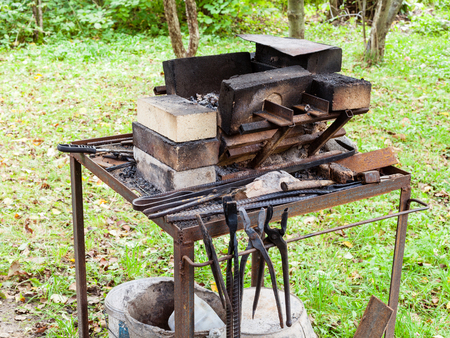 forge of country outdoor blacksmith on backyard