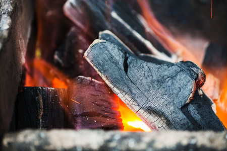 crucible: burning wooden coals in the forge furnace close up