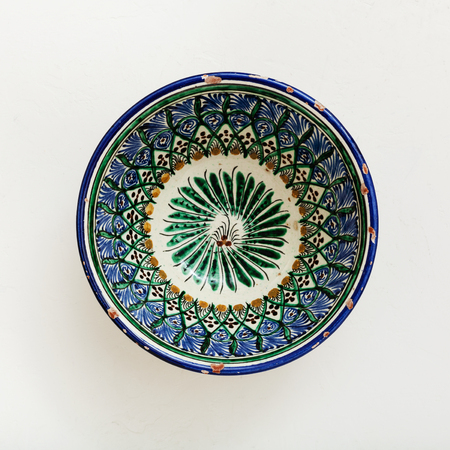 asian bowl: top view of traditional central asian bowl on white plastering plate