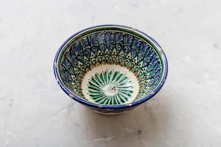 asian bowl: one traditional central asian bowl on gray concrete plate