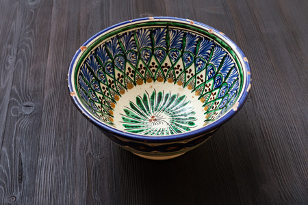 asian bowl: one traditional central asian bowl on dark brown board