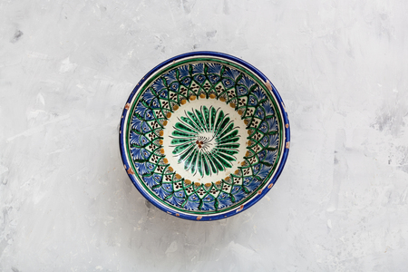 asian bowl: top view of traditional central asian bowl on gray concrete plate Stock Photo