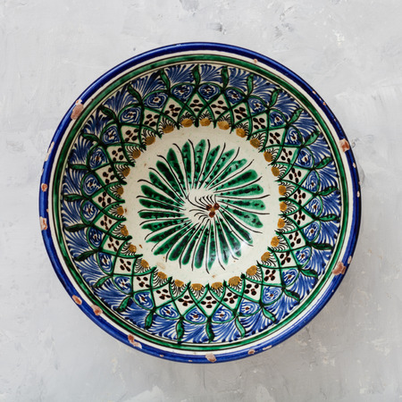 asian bowl: above view of typical central asian bowl on gray concrete plate Stock Photo