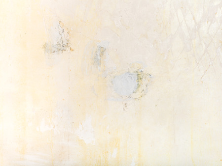 cleared: construction background - cleared wall with patches of fresh putty before wallpapering