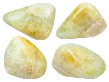 set of various polished datolite gemstones isolated on white background